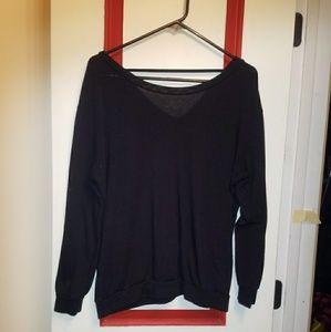 Black sweater with wing back detail
